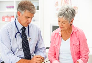 image of woman speaking to her doctor about vertigo